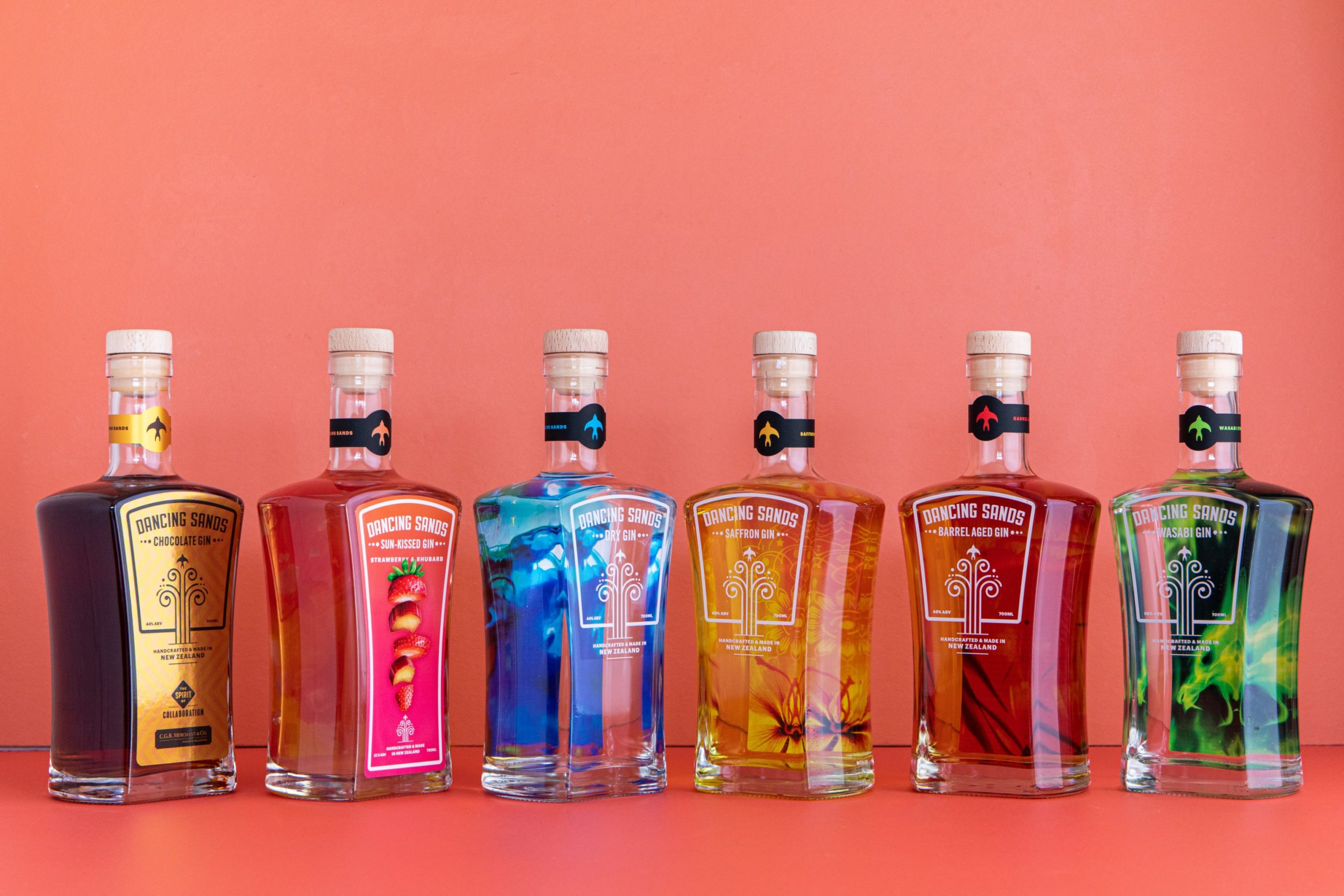 Dancing Sands gin family: Dry, Sun-Kissed, Barrel Aged, Wasabi, Saffron, and Chocolate gins