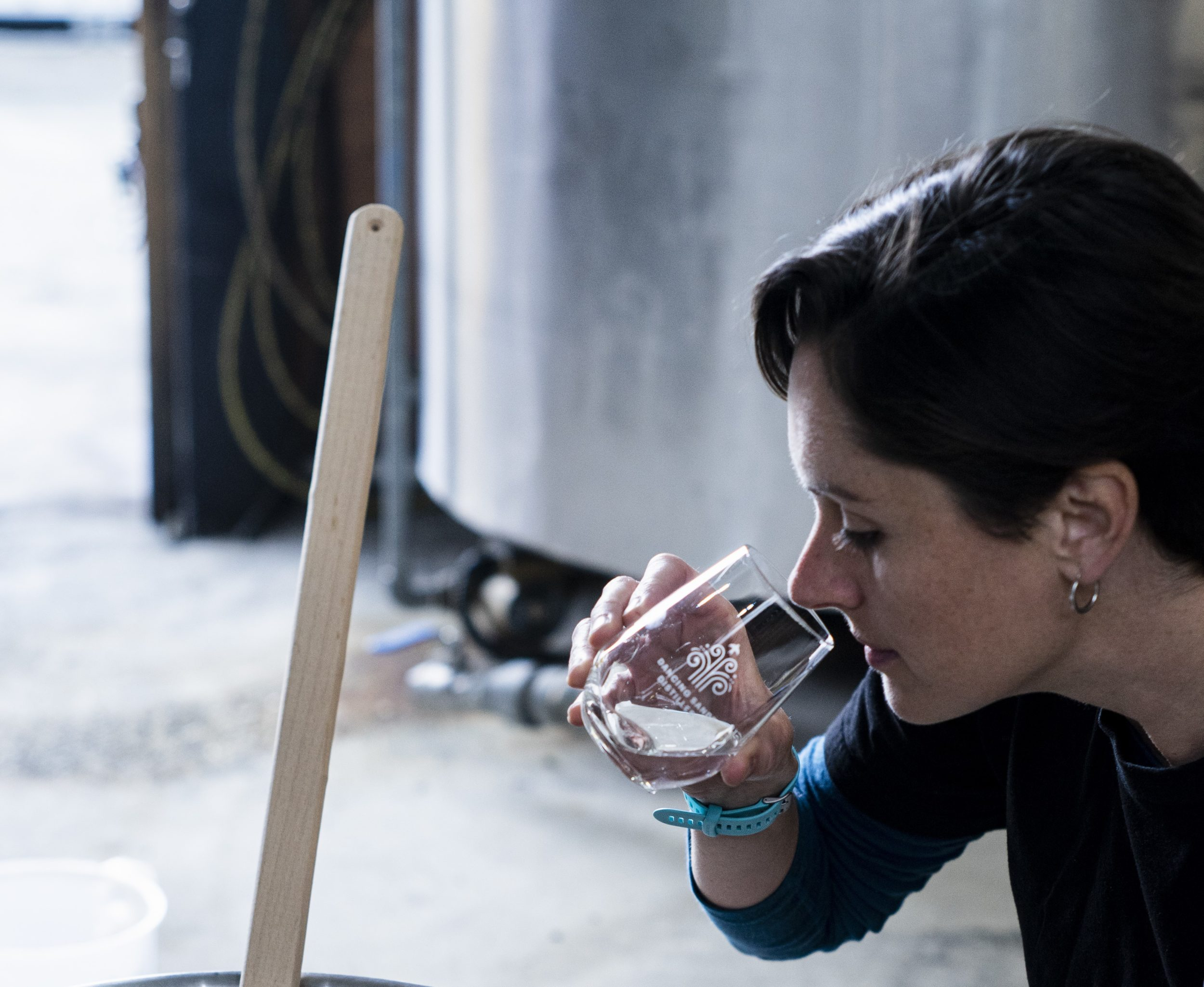 Sarah tasting Dancing Sands gin to test its quality